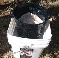 Boiled Lint Draining in Bucket